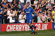 AFC Wimbledon striker Kweshi Appiah (9) celebrating after scoring goal to make it 2-0 during the EFL Sky Bet League 1 match between AFC Wimbledon and Bury at the Cherry Red Records Stadium, Kingston, England on 5 May 2018. Picture by Matthew Redman.