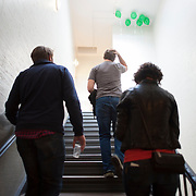 """October 14, 2012 - New York, NY : From left, Artsicle creative director Dan Teran and co-founders Scott Carleton and Alex Tryon climb the stairs in Brooklyn Art Space on Saturday afternoon. .The trio spent Saturday afternoon touring artist studios during the """"Gowanus Open Studios"""" arts walk. Founded in 2010, Artsicle rents works of art to individuals and corporations.  CREDIT: Karsten Moran for The New York Times"""