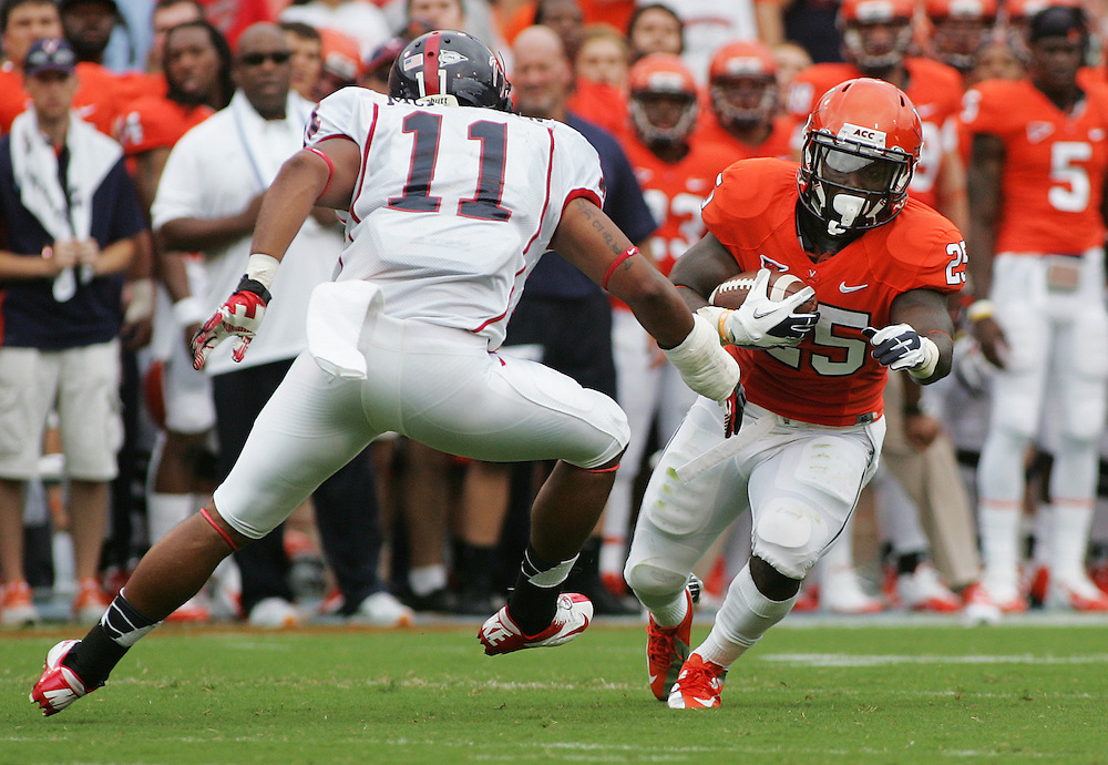 Sept 1, 2012; Charlottesville, VA, USA;  Virginia Cavaliers running back Kevin Parks (25) rushes the ball against Richmond Spiders linebacker Darius McMillan (11) at Scott Stadium. Mandatory Credit: Peter Casey-US PRESSWIRE