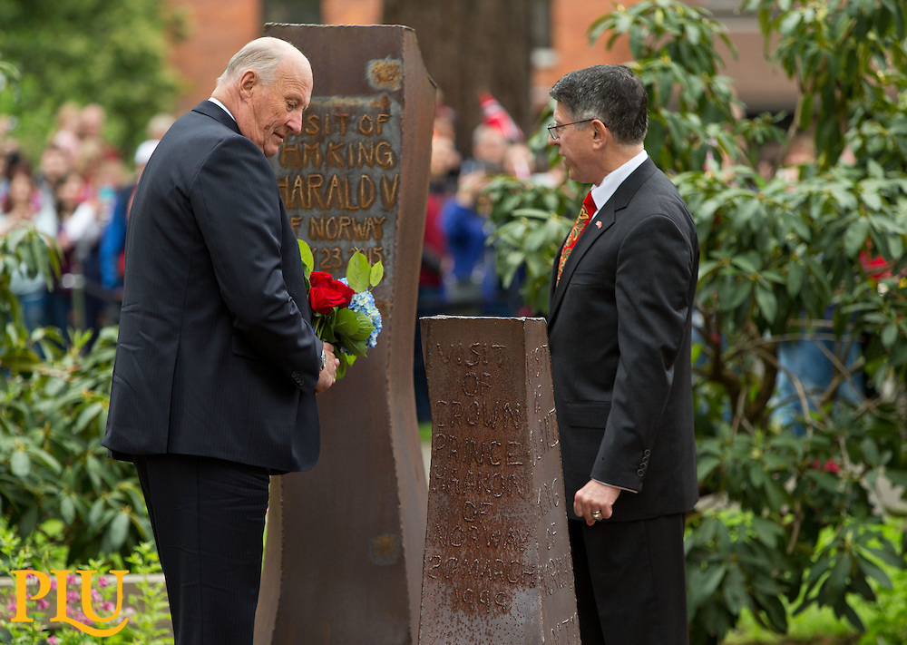 President Thomas Krise and HM King Harald V of Norway stand in the rune sculpture with the inscription commemorating his visit of to Pacific Lutheran University on Saturday, May 23, 2015. Later His Majesty delivered the commencement address and received an honorary degree. (Photo: John Froschauer/PLU)