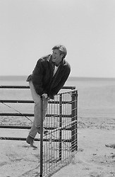 Man enjoying swinging on a gate in the country