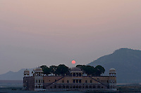 The sun rises over the water palace, in Jaipur City india Nov. 16, 2006 Jaipur India.    (photo by Darren Hauck).........