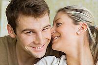 Close-up beautiful young woman kissing man