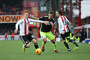 Brentford midfielder Ryan Woods (15) and Brighton & Hove Albion central defender Uwe Huenemeier (4) during the EFL Sky Bet Championship match between Brentford and Brighton and Hove Albion at Griffin Park, London, England on 5 February 2017.