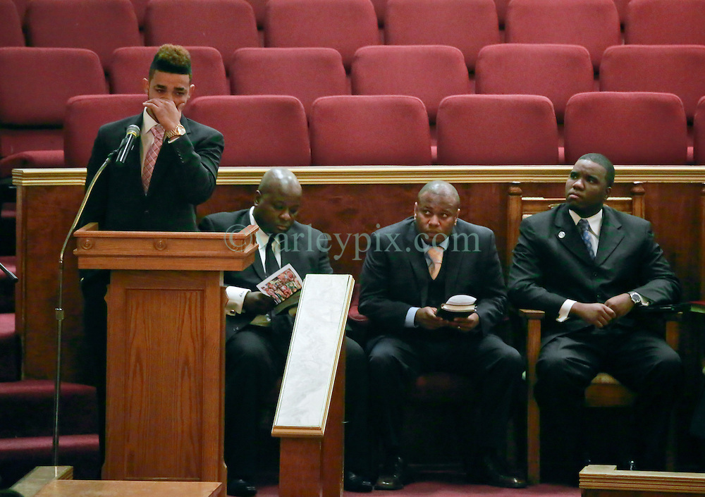07 September 2013. New Hope Baptist Church. New Orleans, Louisiana. <br /> Keion Reed (20 yrs) gives an emotional address at the funeral of his daughter, 1 year old toddler Londyn Unique Reed Samuels, shot to death August 29th.  The infant Londyn was shot by thugs whilst in the arms of her babysitter, the intended victim who was holding Londyn whilst walking down the street at the time of the assault. NOPD has arrested 2 men in connection with the heinous crime.<br /> Photo; Charlie Varley