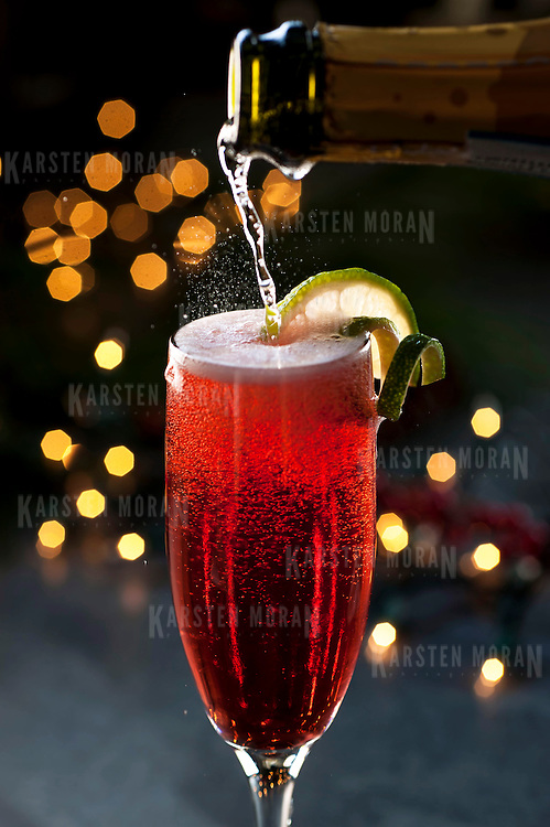 "December 2, 2013 - New York, NY : A selection of holiday cocktails, prepared and styled by Suzanne Lenzer, include the ""Christmas Spritz,"" a prosecco-based drink made with pomegranate juice. CREDIT: Karsten Moran for The New York Times"