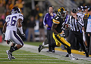 October 15, 2011: Iowa Hawkeyes wide receiver Marvin McNutt (7) pulls in a pass as Northwestern Wildcats cornerback Jordan Mabin (26) defends during the second half of the NCAA football game between the Northwestern Wildcats and the Iowa Hawkeyes at Kinnick Stadium in Iowa City, Iowa on Saturday, October 15, 2011. Iowa defeated Northwestern 41-31.