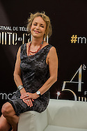French actress Fanny Cottencon poses during a photocall for the TV show 'Interventions' as part of the 54th Monte-Carlo Television Festival on June 8, 2014 in Monaco.