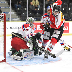COBOURG, - Dec 18, 2015 -  WJAC Game 11- Team Czech Republic vs Team Switzerland at the 2015 World Junior A Challenge at the Cobourg Community Centre, ON. Dominik Groh #2 of Team Czech Republic protects the crease from Fabian Berni #9 of Team Switzerland during the first period.(Photo: Andy Corneau / OJHL Images)