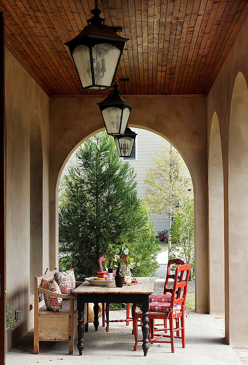 The back porch of Vickey Village home designed like a Tuscan villa for family living.