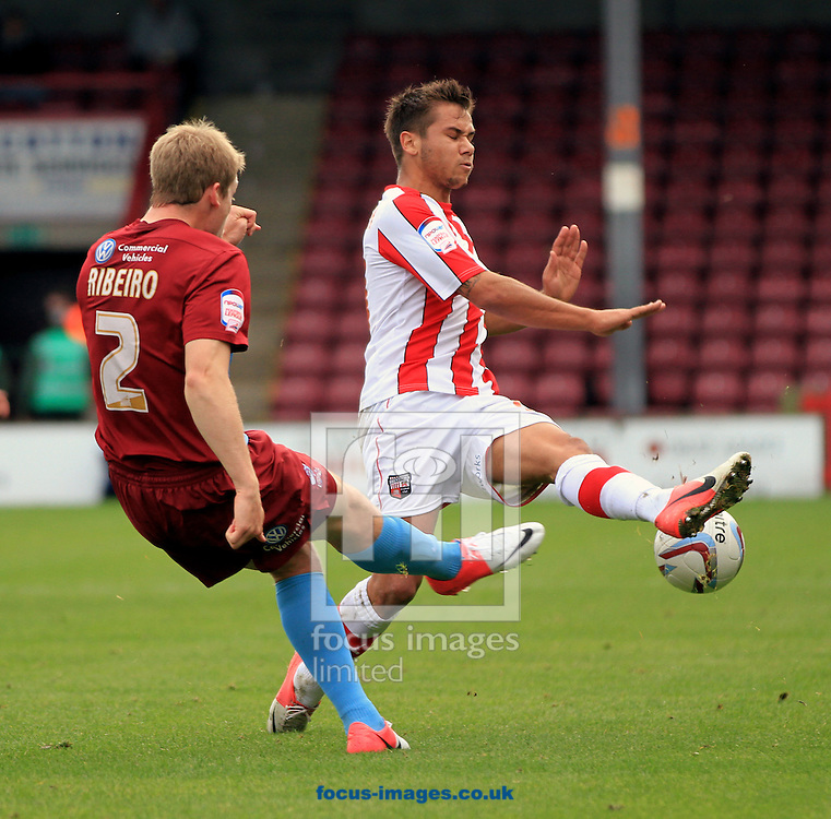 Picture by Richard Gould/Focus Images Ltd +447814 482222.13/10/2012.Christian Ribeiro (2) of Scunthorpe United Harry Forrester of Brentford in action  during the npower League 1 match at Glanford Park, Scunthorpe.