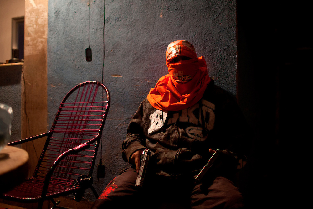 In this Aug. 11, 2012 photo, a masked and armed trafficker poses for a photo at a drug selling point that no longer sells crack in the Mandela slum in Rio de Janeiro, Brazil. <br /> <br />  The South American country began experiencing a public health emergency in recent years as demand for crack boomed and open-air &quot;cracolandias,&quot; or crack lands, popped up in the sprawling urban centers of Rio and Sao Paulo, with hundreds of users gathering to smoke the drug. The federal government announced in early 2012 that more than $2 billion would be spent to fight the epidemic, with the money spent to train local health care workers, purchase thousands of hospital and shelter beds for emergency treatment, and create transitional centers for recovering users.