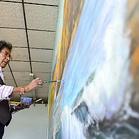 070114       Cayla Nimmo<br /> <br /> Richard Yazzie works on the water detail to hs mural inside Nu Kreations Salon in Gallup Tuesday morning.