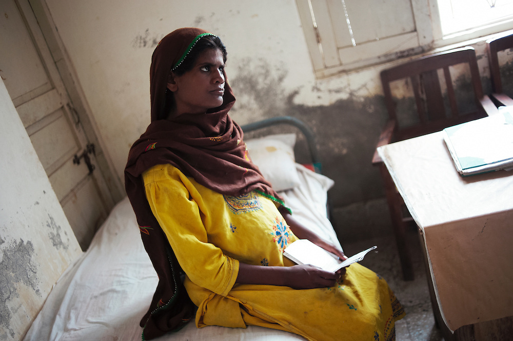 Zebo Mumoon Haroon sits in the Tarqwaja Government Dispensary, Thatta, Sindh, Pakistan on June 30, 2011. She has  3 children, 3, 5 and 7 years old. She is 28 years old and 9 months pregrant.