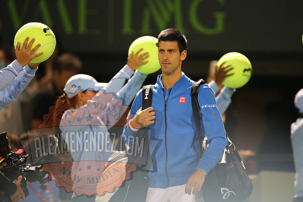 Novak Djokovic, of Serbia, enters the court area prior to his match against Martin Klizan, of Slovakia, at the Miami Open tennis tournament on Saturday, March 28, 2015 in Key Biscayne, Florida. Djokovic defeated Klizan 6-0, 5-7, 6-1(AP Photo/Alex Menendez)