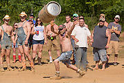 A competitor tosses a beer barrel during the 2015 National Red Neck Championships May 2, 2015 in Augusta, Georgia. Hundreds of people joined in a day of country sport and activities.