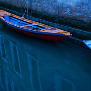 Boats moored in moonlight to brick wall on the Rio di Santa Maria Zobenigo, San Marco Sestiere, Venice, Italy<br />