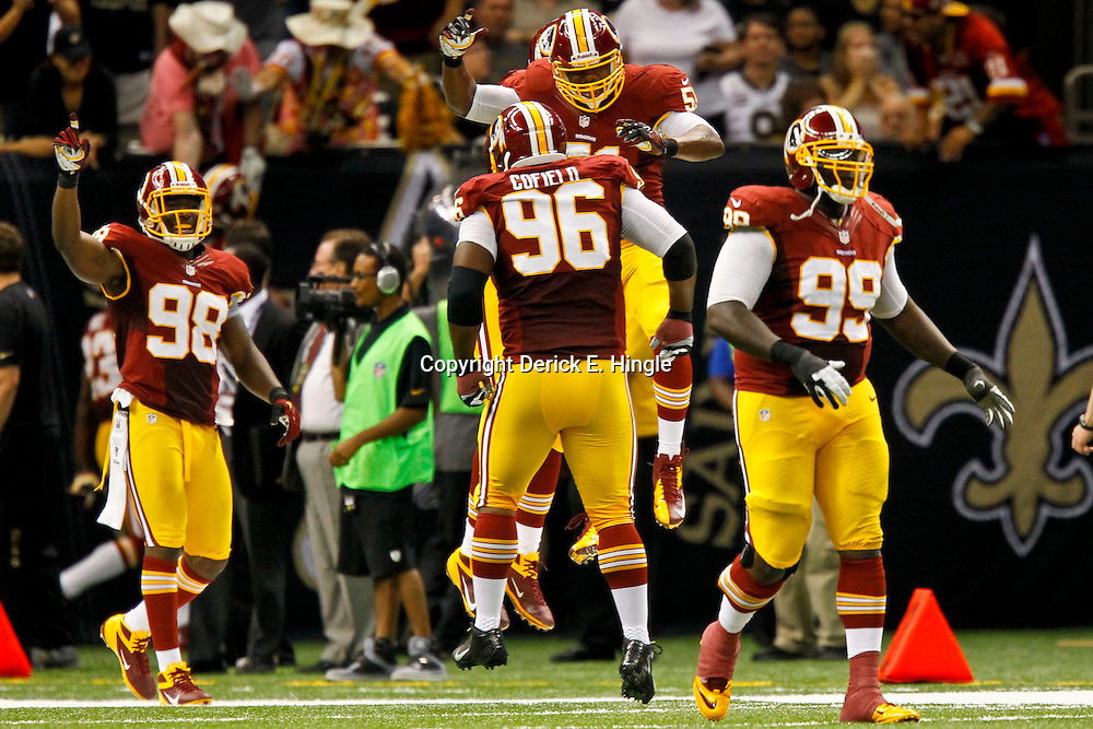 September 9, 2012; New Orleans, LA, USA; Washington Redskins defensive players celebrate after an interception  during the fourth quarter of a game against the New Orleans Saints at the Mercedes-Benz Superdome. The Redskins defeated the Saints 40-32. Mandatory Credit: Derick E. Hingle-US PRESSWIRE