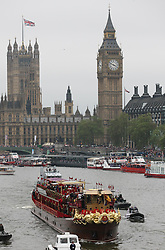 The Royal Barge passes the Houses of Parliament during the Thames Diamond Jubilee Pageant in London, Sunday 3rd  June 2012.  Photo by: Stephen Lock / i-Images