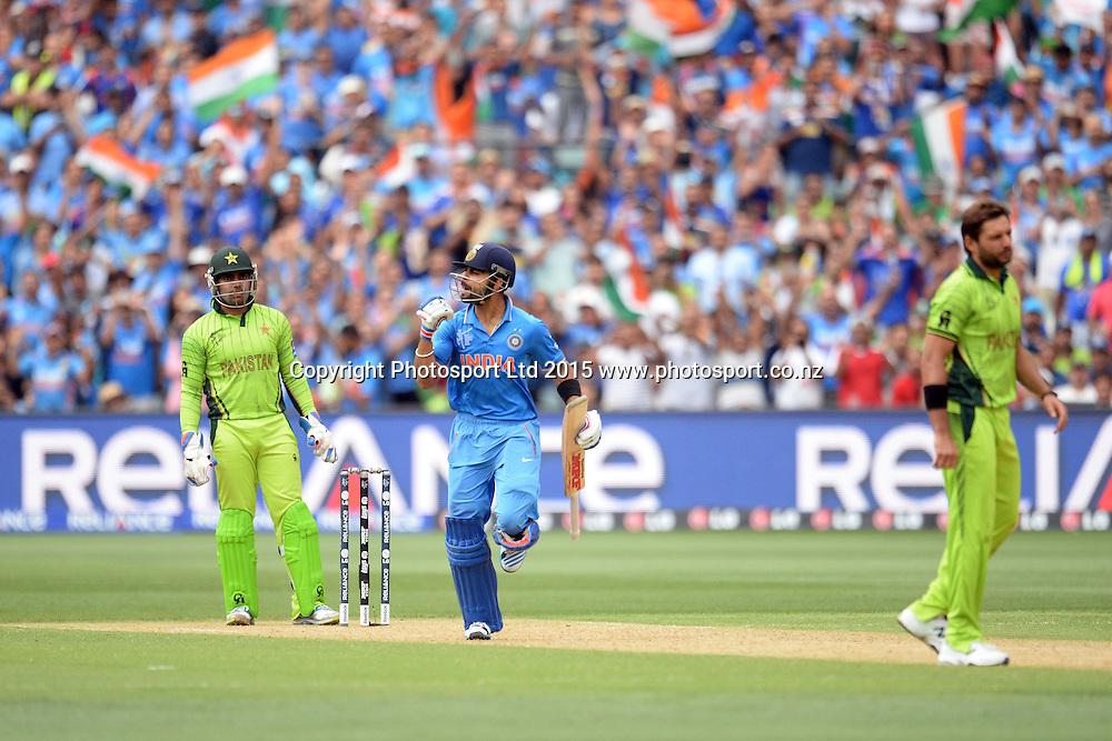 Indian batsman Virat Kohli celebrates his hundred during the ICC Cricket World Cup match between India and Pakistan at Adelaide Oval in Adelaide, Australia. Sunday 15 February 2015. Copyright Photo: Raghavan Venugopal / www.photosport.co.nz