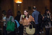 After the congregation, a woman is having a refreshment at The Sunday Assembly (today held inside Conway Hall in central London), an atheist service founded by British comedians Sanderson Jones and Pippa Evans in 2013, in London, England. The gathering is designed to bring together non-religious people who want a similar communal experience to a religious church. Satellite assemblies have been established in over 30 cities including New York, San Diego, and Dublin.