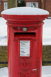 A red Royal Mail post box, in Cherry Willingham, Lincoln with a covering of snow on top of it.<br /> <br /> Picture: Chris Vaughan Photography<br /> Date: February 27, 2018