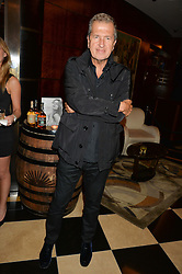 MARIO TESTINO at the London launch of Casamigos Tequila hosted by Rande Gerber, George Clooney & Michael Meldman and to celebrate Cindy Crawford's new book 'Becoming' held at The Beaumont Hotel, Brown Hart Gardens, 8 Balderton Street, London on 1st October 2015.