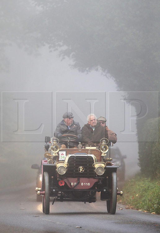 © Licensed to London News Pictures. 01/11/2015. Staplefield, UK. An 1899 Panhard et Levassor drives along a foggy road near Staplefield as it takes part in the London to Brighton Veteran Car Run.  Photo credit: Peter Macdiarmid/LNP