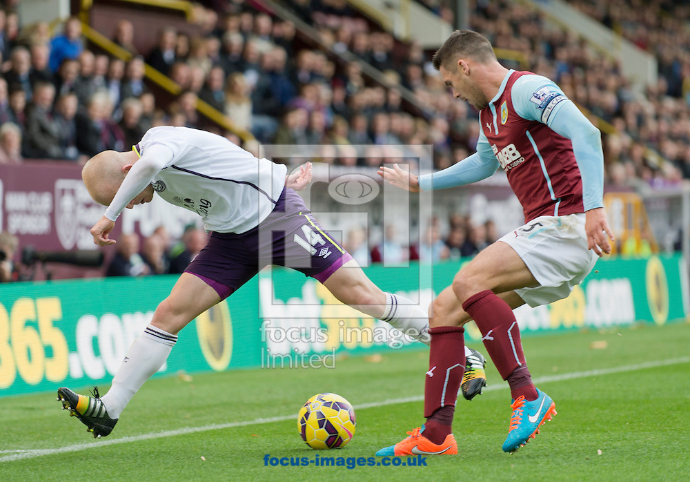 Steven Naismith of Everton (left) and Jason Shackell of Burnley challenge for the ball during the Barclays Premier League match at Turf Moor, Burnley<br /> Picture by Russell Hart/Focus Images Ltd 07791 688 420<br /> 26/10/2014