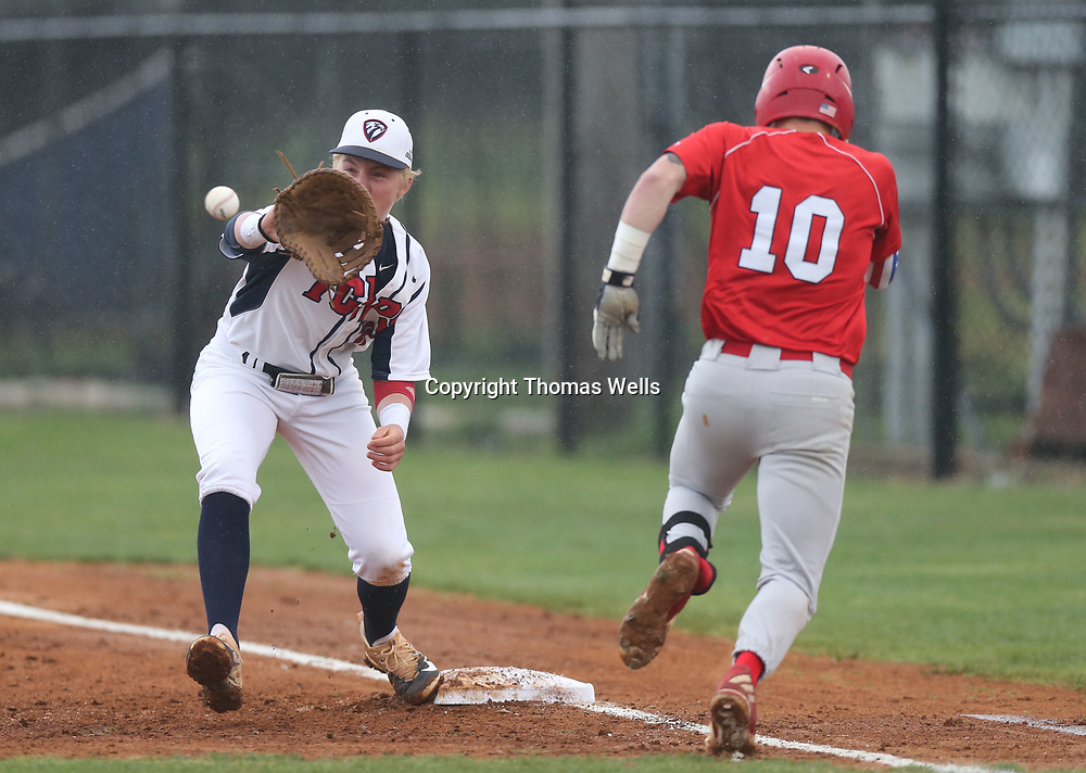 Hunter Elliot keeps an eye on the ball as the throw reaches him at first base to get Pine Grove batter Cooper Park out in the first inning on Thursday.