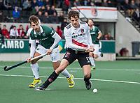 AMSTELVEEN - Boris Burkhardt (Adam) met Tristan Algera (Rdam)     tijdens de hoofdklasse hockeywedstrijd Amsterdam-HC Rotterdam (7-1).    COPYRIGHT KOEN SUYK