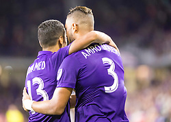 August 4, 2018 - Orlando, FL, U.S. - ORLANDO, FL - AUGUST 04: Orlando City defender Amro Tarek (3) celebrates with Orlando City defender Mohamed El-Munir (13) during the MLS soccer match between the Orlando City SC and  New England Revolution on August 4th, 2018 at Orlando City Stadium in Orlando, FL. (Photo by Andrew Bershaw/Icon Sportswire) (Credit Image: © Andrew Bershaw/Icon SMI via ZUMA Press)