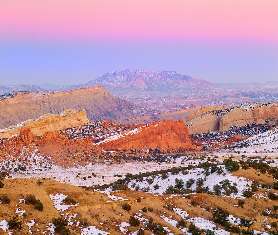 0304-1003 ~ Copyright:  George H. H. Huey ~ The Henry Mountains at dusk, winter, seen from the top of the Waterpocket Fold.  Capitol Reef National Park, Utah.