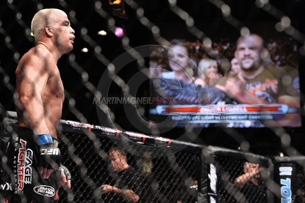 "LAS VEGAS, NEVADA, MAY 24, 2008: Tito Ortiz (left) stands ready in his corner whilst an image of rival Chuck Liddell can be seen on a screen during ""UFC 84: Ill Will"" inside the MGM Grand Garden Arena in Las Vegas"