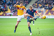 Jake Hastie (#35) of Motherwell FC gets to the ball ahead of Christophe Berra (#6) of Heart of Midlothian during the Ladbrokes Scottish Premiership match between Motherwell FC and Heart of Midlothian FC at Fir Park, Stadium, Motherwell, Scotland on 17 February 2019.