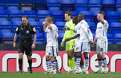 BIRKENHEAD, ENGLAND - Saturday, April 21, 2012: Tranmere Rovers' players argue with referee Mick Russell after a mix up over which player he had given a red card during the Football League One match against Hartlepool United at Prenton Park. (Pic by David Rawcliffe/Propaganda)