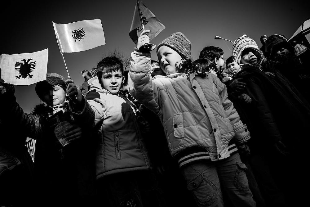 School children celebrate Albanian Flag day in Pristina