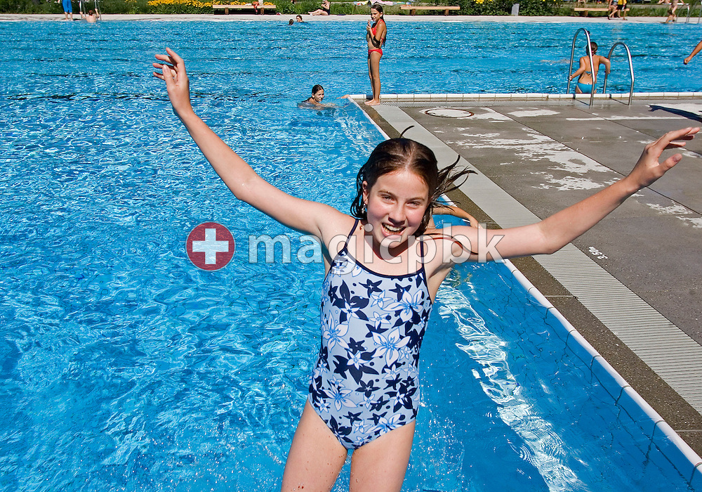 A teenaged girl jumps in the water at the public outdoor swimming pool on Wednesday August 31, 2005 in Zurich-Seebach, Switzerland. (Photo by Patrick B. Kraemer / MAGICPBK)