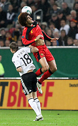 11.10.2011, Esprit Arena, Duesseldorf, GER, UEFA EURO 2012 Qualifikation, Deutschland (GER) vs Belgien (BEL), im Bild..Tino Kroos (GER) gegen Marouane Fellaini (Belgien)..// during the UEFA Euro 2012 qualifying round Germany vs Belgium  at Esprit Arena, Duesseldorf 2011-10-11 EXPA Pictures © 2011, PhotoCredit: EXPA/ nph/  Hessland       ****** out of GER / CRO  / BEL ******