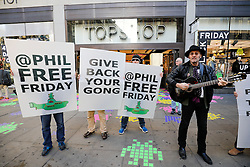 "© Licensed to London News Pictures. 25/11/2016. London, UK. An anti Philip Green demonstration outside TOPSHOP on Oxford Street, London, in the early hours on ""Black Friday"". Sales from this years Black Friday event are expected to top £2 billion. Photo credit: Tolga Akmen/LNP"