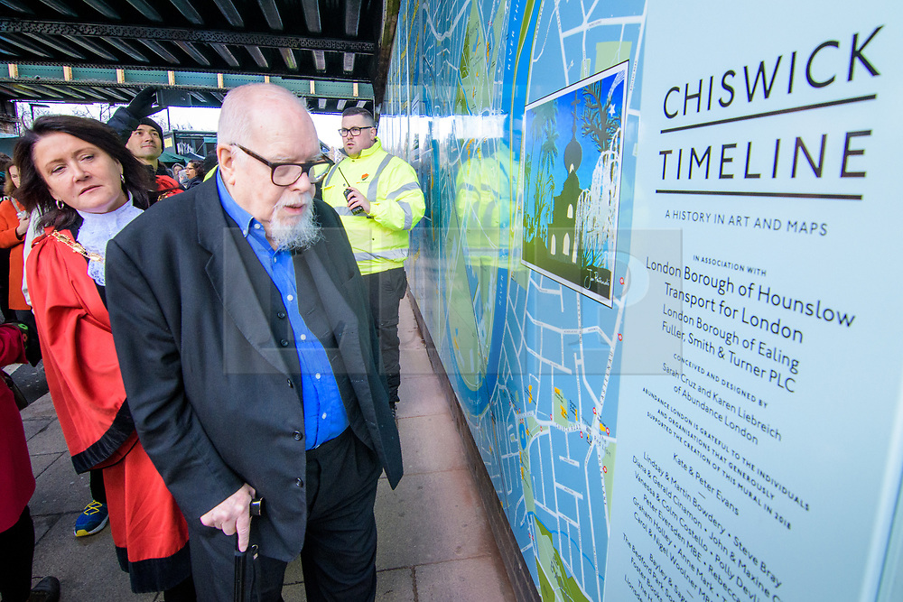 © Licensed to London News Pictures. <br /> 28/1/2018. London, Great Britain.  <br /> Sir Peter Blake opens The Chiswick Timeline, a history in art and Maps watched by the Mayor of Hounslow, Clr. Sue Sampson on the right<br /> 16 large historic maps and 23 works of art by leading artists showing Chiswick landmarks.<br /> The Chiswick Timeline celebrates the history of a part of London that was once a village west of the capital on the banks of the River Thames.<br /> The landmark work of art is situated under the railway bridges under Turnham Green tube station.<br /> <br /> Photo credit: Anthony Upton/LNP