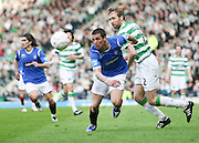 Nacho Novo beats Andreas Hinkel during the League Cup final between Rangers and Celtic at Hampden Park -<br /> David Young Universal News And Sport