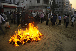 Protesters set fire during a countrywide general strike in Dhaka, capital of Bangladesh, March 4, 2013. At least three protesters were shot dead in Bangladesh when riot police clashed with demonstrators during a 48-hour strike called by Bangladesh s largest Islamist party Jamaat-e-Islami, demanding release of its leaders who face charges of war crimes, March 4, 2013.,  March 4, 2013. Photo by Imago / i-Images...UK ONLY