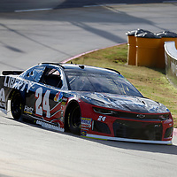 William Byron (24) races through turn three to practice  for the First Data 500 at Martinsville Speedway in Martinsville, Virginia.