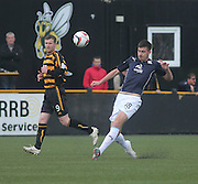 Declan Gallagher clears as Alloa Athletic's Andrew Kirk watches - Alloa Athletic v Dundee, SPFL Championship at Recreation Park, Alloa<br /> <br />  - &copy; David Young - www.davidyoungphoto.co.uk - email: davidyoungphoto@gmail.com