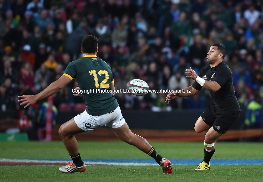 JOHANNESBURG, South Africa, 25 July 2015 : Lima Sopoaga of the All Blacks puts his backline away with Damian de Allende of the Springboks the defender during the Castle Lager Rugby Championship test match between SOUTH AFRICA and NEW ZEALAND at Emirates Airline Park in Johannesburg, South Africa on 25 July 2015. Bokke 20 - 27 All Blacks<br /> <br /> &copy; Anton de Villiers / SASPA