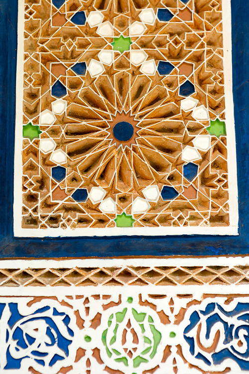 Moroccan zellije mosaic wall / doorway tiling, Bahia Palace, Marrakesh, Morocco, 2016–04-21. <br />