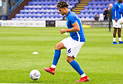 Macclesfield Town defender Theo Vassell warming up before the EFL Sky Bet League 2 match between Macclesfield Town and Morecambe at Moss Rose, Macclesfield, United Kingdom on 20 August 2019.