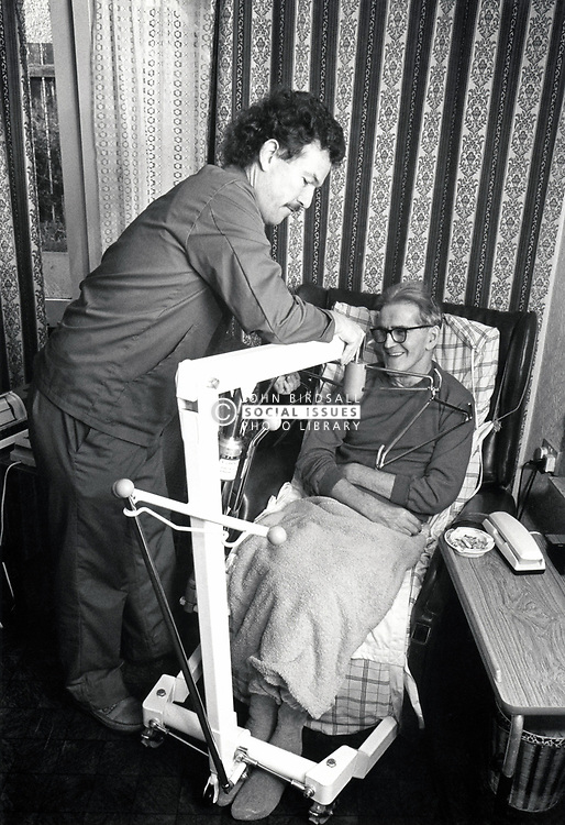 Disabled man at home with carer, UK 1989