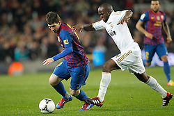 25.01.2012, Stadion Camp Nou, Barcelona, ESP, Copa del Rey, FC Barcelona vs Real Madrid, im Bild Barcelona's Lionel Messi and Real Madrid's Lassana Diarra // during the football match of spanish Copy del Rey, between FC Barcelona and Real Madrid at Camp Nou stadium, Barcelona, Spain on 2012/01/25. EXPA Pictures © 2012, PhotoCredit: EXPA/ Alterphotos/ Cesar Cebolla..***** ATTENTION - OUT OF ESP and SUI *****